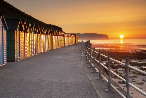 Beach huts and the sunset at Whitby